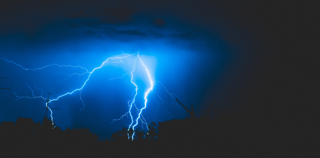 Banner picture of lightning striking downwards towards the ground.